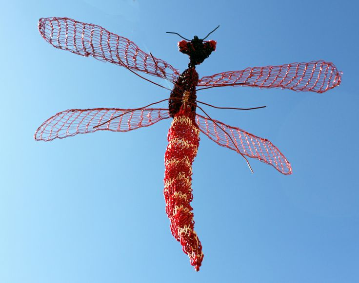 This piece is created on a knitting frame using recycled electrical wire, both plastic coated and copper. It has 50cms wingspan, 40cms long body and stands 18cms from the floor.
