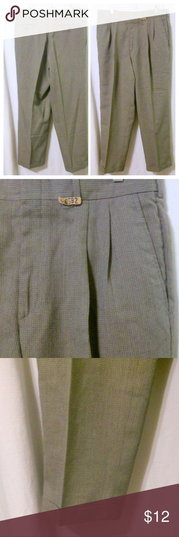 "Savane Men's Pleated Front Dress Slacks? These men's dress slacks are made by Savane. They are done in a polyester wool blend and feature a pleated front and cuffed legs. Measurements are: Waist 36"", inseam 30"". In great condition! Savane Pants Dress"