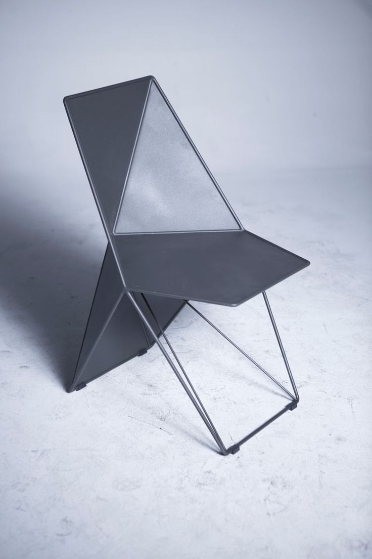 Handmade from metal, the modern and geometric Monumental Chair, designed by Eray Carbajo, references crystalline forms typically found in nature.