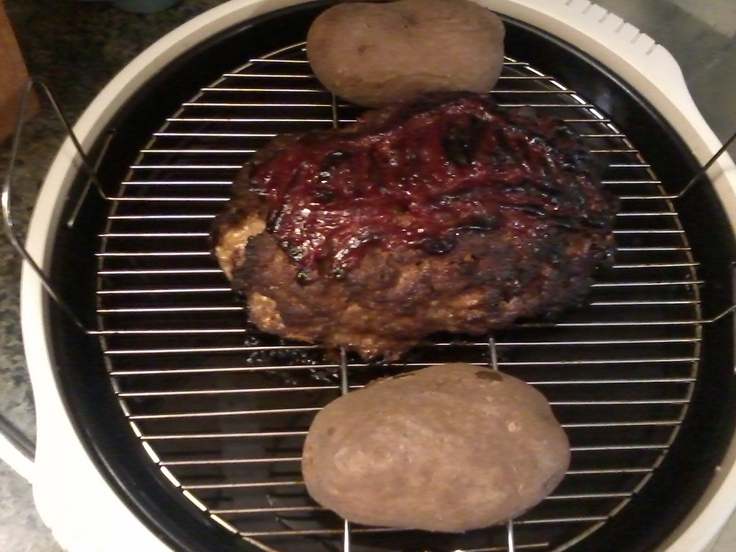 Terry R. sent us this photo of his meatloaf and baked potato dinner, cooked together in his NuWave Oven Pro! He was even kind enough to share his recipe, which we have on our Facebook page!    http://www.facebook.com/photo.php?fbid=10151300120370412=a.10150217822660412.353028.94181735411=1