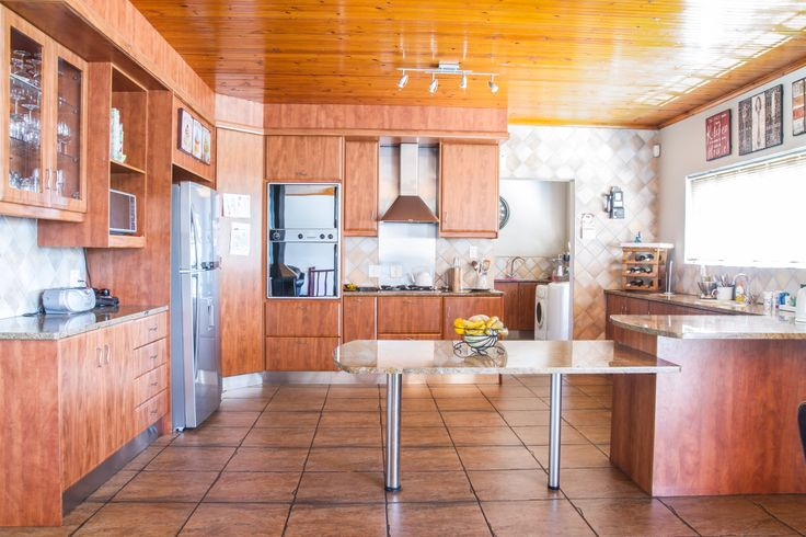 The kitchen is made up of choice finishes complete with oven and hob. Adjacent to the kitchen is the washroom which in turn has a door that leads to a room which is currently being used as a study.