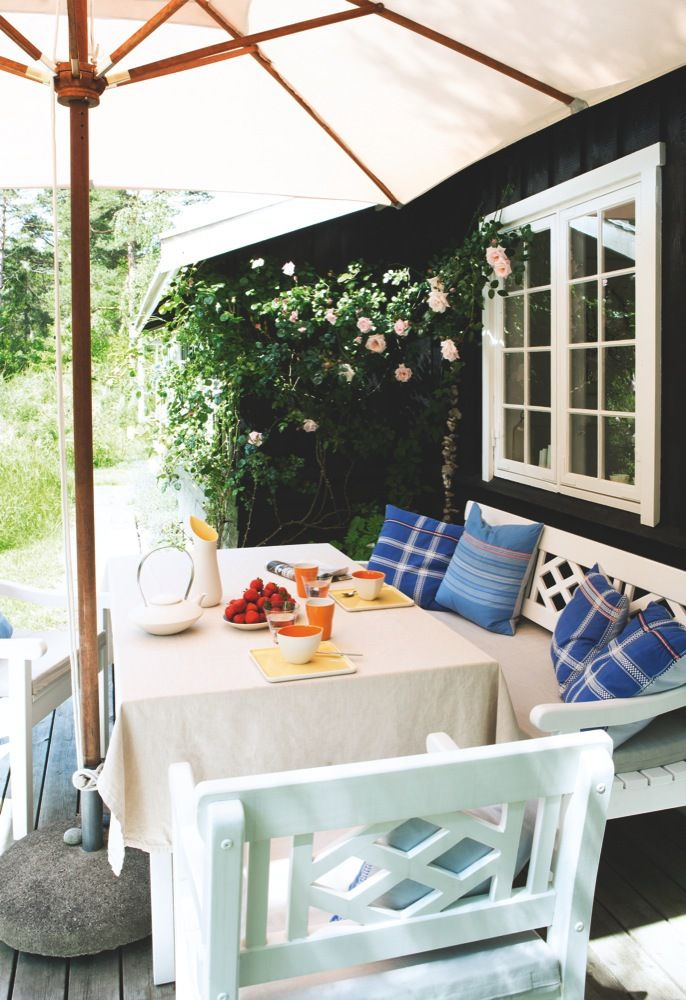 The terrace of designer Ditte Fischer's summerhouse in Tisvilde, Denmark. Built in 1936, the house had been left untouched since 1958 before it was given its current, classic look.