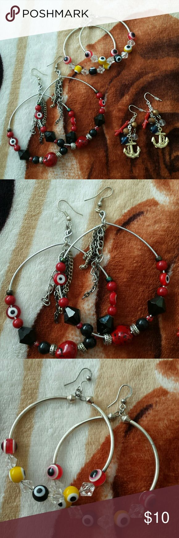 NWOT Earrings Bundle 1 pair of silver hoops with red, black & silver beads, silver and black hanging chain. 1 pair of silver hoops with red, black, yellow & clear beads. 1 pair of silver dangling chain earrings with golden anchor, blue, brown, bronze & clear beads with red hanging coral.  Feel free to ask any questions and or bundle for better pricing. If interested in just one pair feel free to comment. Jewelry Earrings