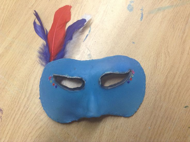 Renaissance Art: Mask using Airbrush,glitter, rhinestones, feathers and clay!