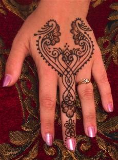 henna.  I used to put henna tattoos on my friends and myself all of the time.  I stopped about 5 years ago due to time restraints.  Seeing things like this makes me want to start back up again.