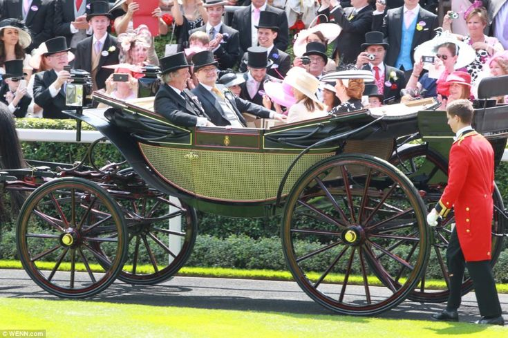 Sir Terry Wogan and his wife Helen also arrived at the racecourse in a plush horse-drawn carriage with two friends as bright sunshine shone over Berkshire