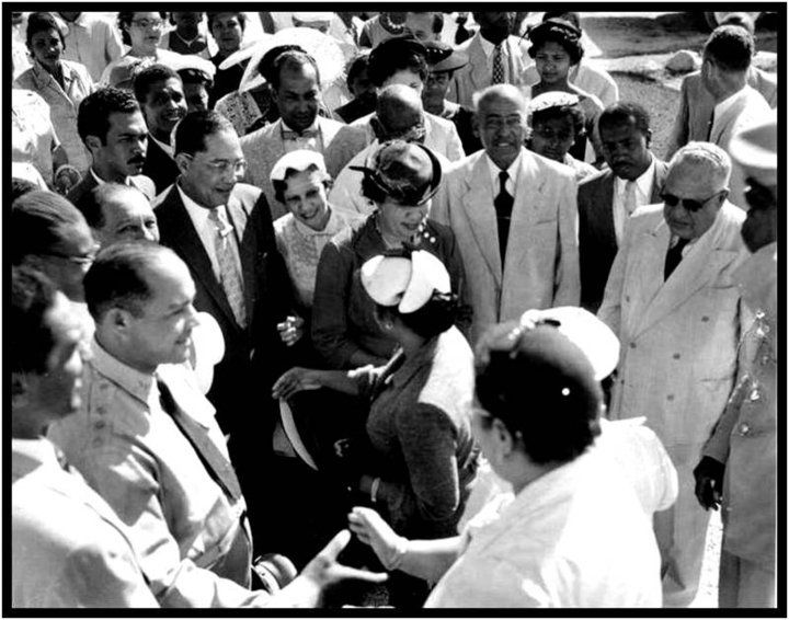 Haiti's then-president Dumarsais Estimé and his wife Lucienne Heurtelou at an official ceremony in Jacmel in the early 1950s. Estimé was practically a success story in Haitian elite society. Born in astonishing poverty, he moved to Port-au-Prince from the small town of Verettes, and thanks to the financial help of an uncle on his father's side of the family, he attended law school, and even married into one of Haiti's most highly-esteemed families the Heurtelous.