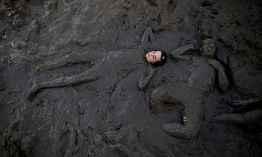 """Dead Sea Israel. Ultra orthodox jews covered with mud enjoying their summer vacation on a men-only beach.""bath in the Courtesy of Guardian News and Media Ltd. (112 pieces)"