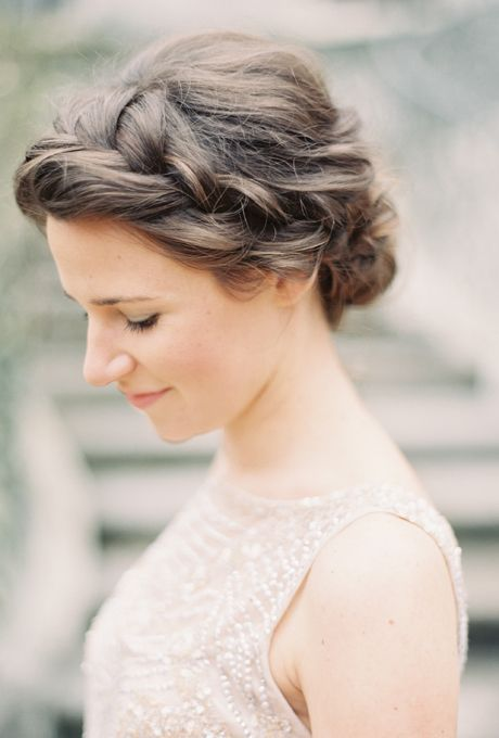 Brides.com:A French-Braided Side Bun. This French-braided bun is a little bohemian, a little fashion forward—and complements practically any face shape (perhaps making it a perfect bridesmaid style, too).