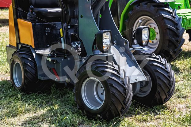 Qdiz Stock Photos | Small tractor agriculture industry,  #agriculture #closeup #country #countryside #farm #farmland #industry #machine #machinery #side #small #technology #tractor