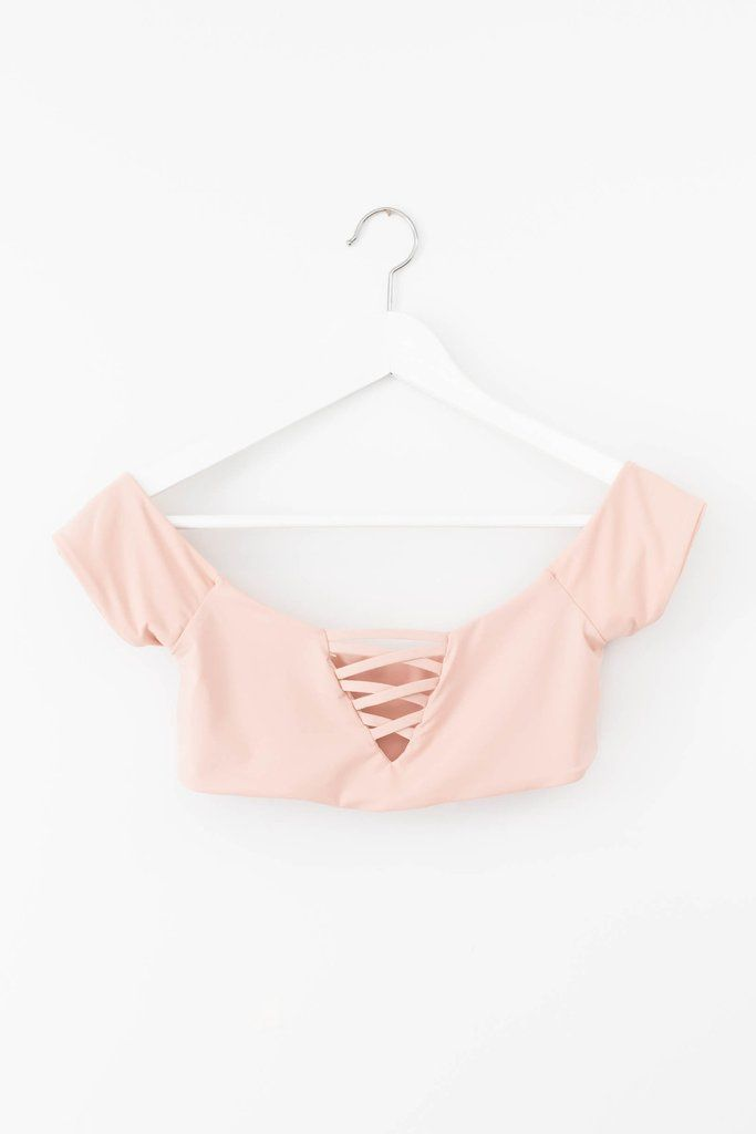 Blush seamless off shoulder swim top with strappy front detailing. Fully lined, not padded.Made and manufactured in the USA at the highest quality standards. W