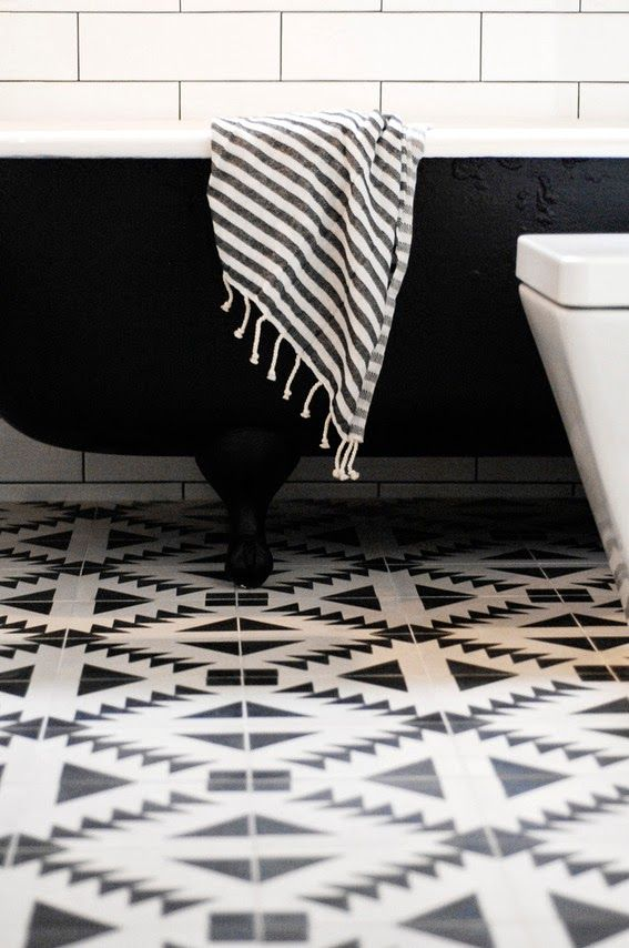 Rosa Beltran Design {Blog} cement concrete encaustic tile moroccan morroccan morocco foyer floor graphic geometric entry hall entryway black walls granada moorish fez patterned clawfoot tub black white southwest tribal
