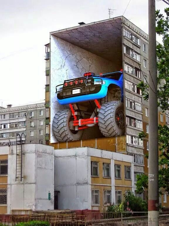 3D Street Art - creating an illusion on the side of an apartment complex - eye-catching!