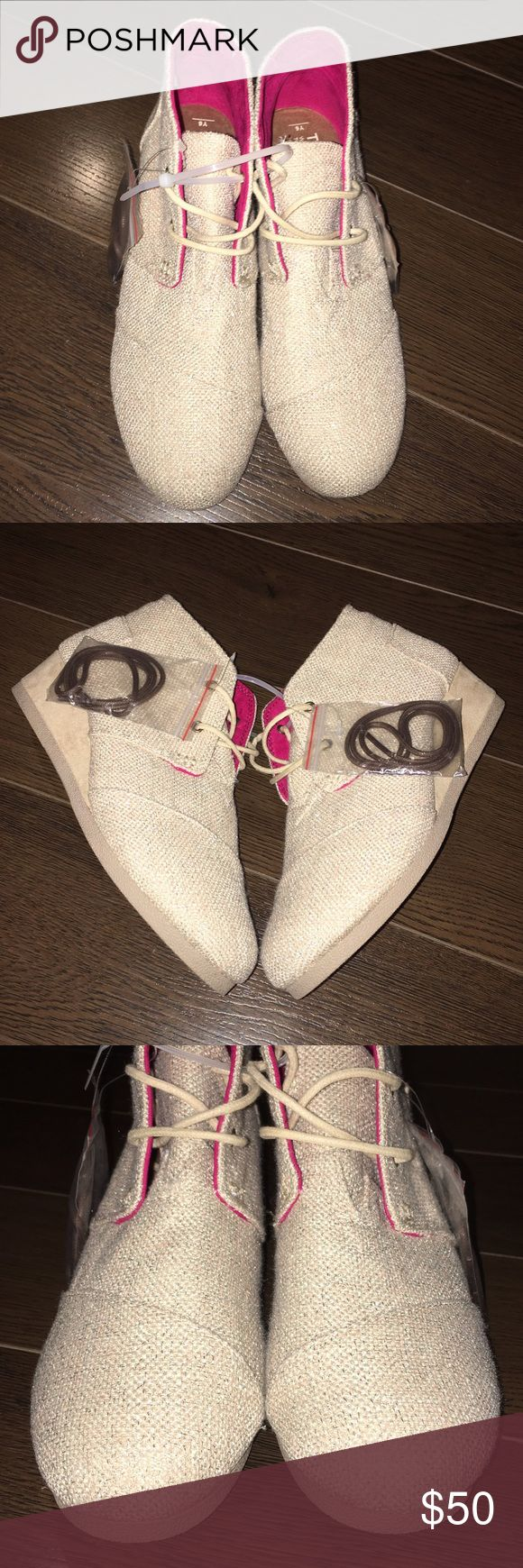 """TOMS Desert Wedge Booties Metallic Gold Burlap Brand new without box, never been worn.  Size 6Y but would also fit size 8 Women.  Comes with additional pair of darker laces. * Gold Metallic Burlap, mid tip silhouette  * Round cap toe with 2 eyelets lace front * Soft texture lining offers a comfortable next-to-skin feel * Lightly cushioned footbed provides both comfort & support * Logo heel patch  * Durable rubber outsole  * Approx 1.5"""" wedge height TOMS Shoes Wedges"""
