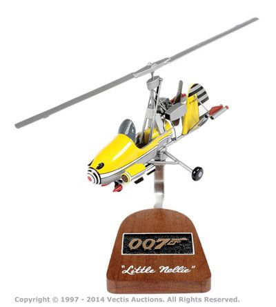 """Lot 245  Griffin Aerospace Models """"James Bond"""" - Gyrocopter """"Little Nellie"""" - taken form the film """"You Only Live Twice"""" - this resin made model is generally Near Mint complete with correct wood and metal display stand and outer brown box - superb example.  Estimate: £110 - £130"""