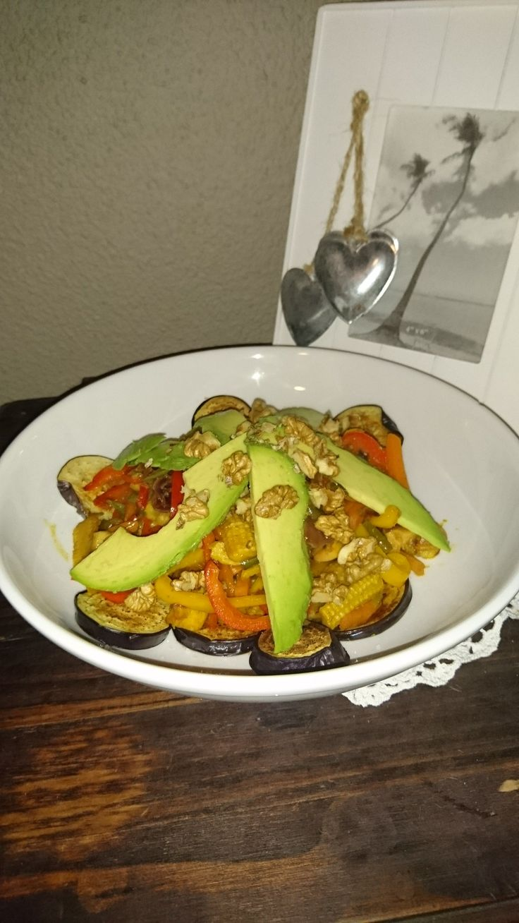 Chicken mixed capsicum stir-fry on a bed of grilled aubergine and topped with avo and walnuts