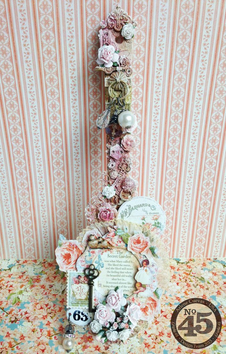 Altered wooden spatula featuring Graphic 45's Secret Garden, an array of embellishments from my stash, and Lindy's Stamp Gang sprays. Super fun project!