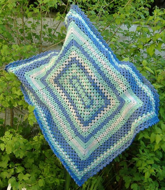 Rectangular Sampler Blanket, free pattern from Underground Crafter. A nice blend of granny clusters, alternating V-stitch, & a couple of rows of popcorn stitch give great textures.  Edging is diagonal box stitch.