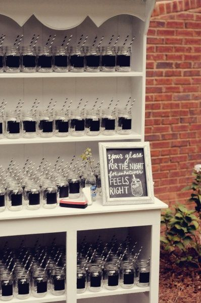 Glasses painted with chalkboard paint so guests can personalize their beverage.