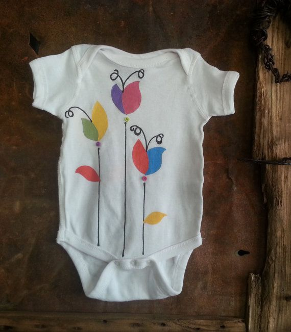 Flower hand dyed baby onesie with buttons. By The Megan Collection on Etsy, $18.00
