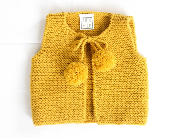 Knit baby vest, garter stitch with pompoms, 100% soft merino wool. Baby girl coming home outfit, Take home outfit by TIENenMIEP on Etsy https://www.etsy.com/listing/237154125/knit-baby-vest-garter-stitch-with