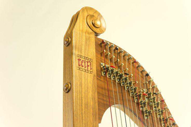 Eos harp scroll by Teifi Harps
