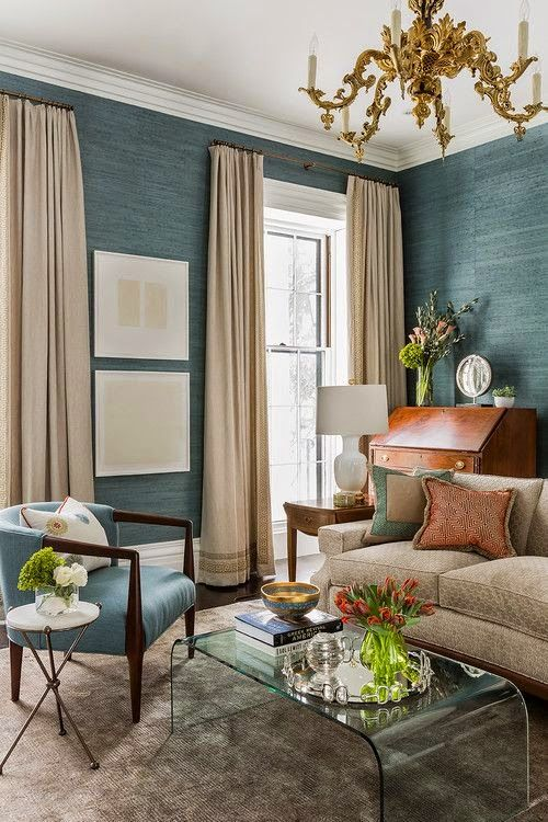teal blue seagrass wallpaper and neutral curtains in an elegant setting