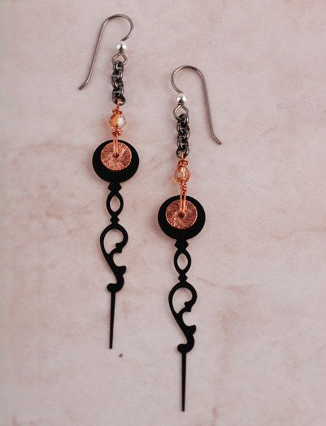 Made from actual black clock hands used for clock repair - the back of the clock hand is white. These long black clock hand earrings are delicate and lightweight. They measure 3.5 (8.9cm) x .5 (1.3cm).  Handcrafted in our studio in Maine. Black clock hands, swarovski crystal, copper wire, copper disks, base metal chain and niobium hypo-allergenic wires.  www.chrononautmercantile.com