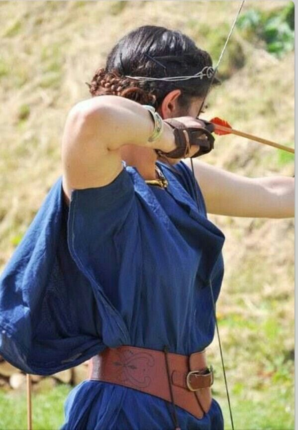 """Princess Ember of Ravensland was once again at the archery range practicing her skills with a bow. She was the oldest of her five siblings and was currently the heir to the throne. To some she was a soldier and to others she was a princess and yet there were those who hated her and her family. """"Knew you would show up today,"""" Anderson chuckled as he walked up. """"Of corse I am,"""" she replied."""