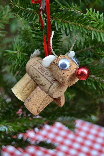Cork reindeer ornament (A very corky Christmas) - This Red Nosed Reindeer is made from two and a half corks, some fabric scraps for his tail and ears, a tiny piece of jute for antlers and the red nose is a bead.