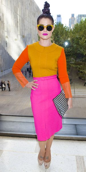 Kelly Osbourne's top knot is a bit much, but the mix of color and printed clutch.