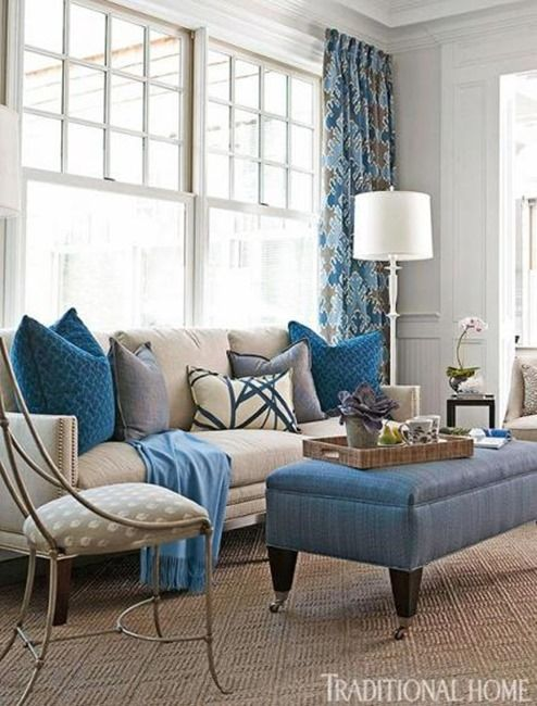 Living Room With Cream Sofa Blue Accents Through The Bench Pillows And Other Decor