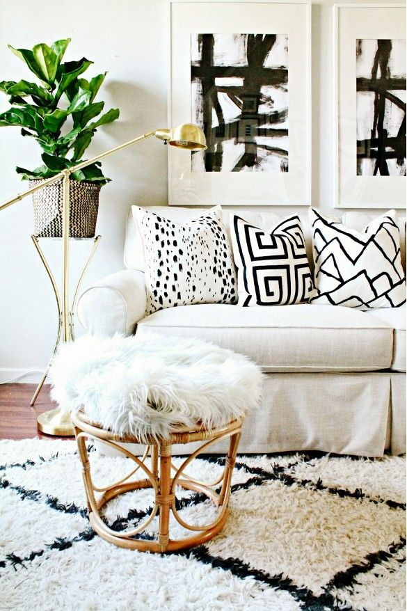 Black and white graphic pillows, lots of textures, simple, clean lines and stripped rugs.