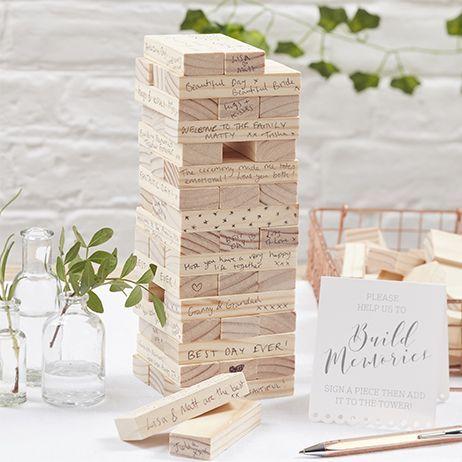 Invitez vos convives à vous laisser un petit mot sur un livre d'or amusant et très original: les blocs de construction! Une belle alternative au livre d'or!