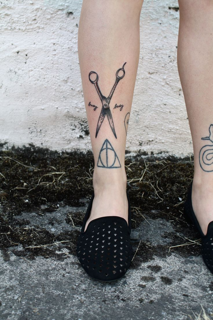 Love both of these tattoos, but I definitely really want those shears!