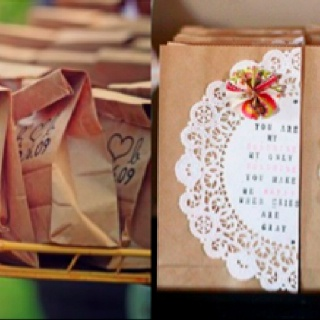 Decorated paper bags to hold wedding favors