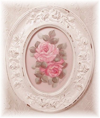 Frames painted white and distressed with roses at the centre.