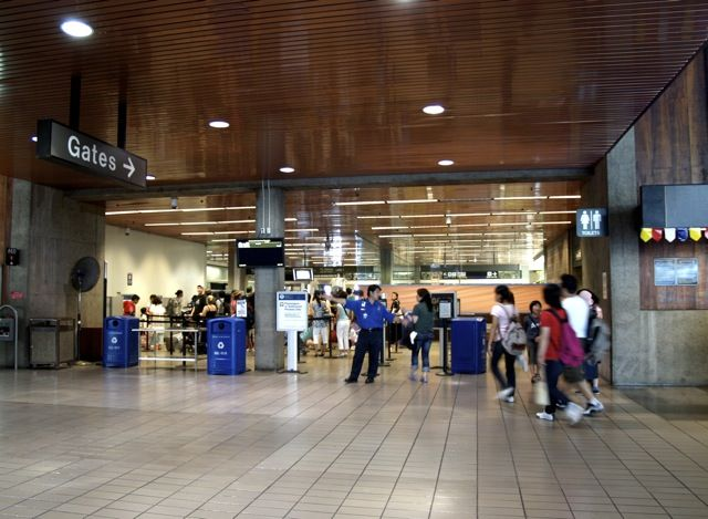 Security Checkpoint of HNL Airport. Is/Are the area/s used in TSA screenings too small, what sort of feeling does the space give you? Secure, being watched, claustrophobic, etc.