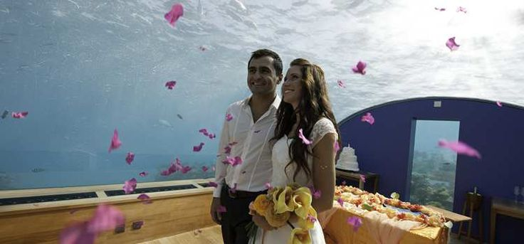 Get married underwater without the scuba gear look - at the Conrad Maldives Rangali Island, part of the Hilton group...