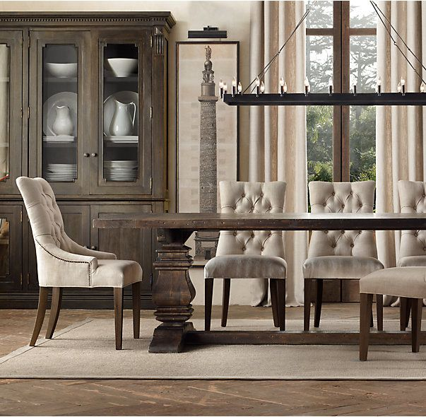 RH's Salvaged Wood Trestle Rectangular Extension Dining Table:Our salvaged trestle wood tables are handcrafted of unfinished, solid salvaged pine timbers from 100-year-old buildings in Great Britain.