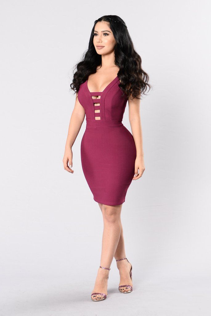- Available in Plum - A Line Dress - Exposed Back Zipper - Sleeveless - Low V Neckline - Strap Details - 95% Polyester 5% Spandex