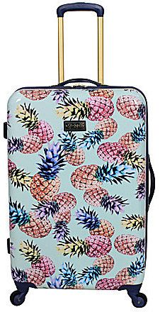 Spot your luggage on the luggage belt at the airport with this crazy cute pineapple print hardside suitcase from Jessica SImpson.    Affiliate