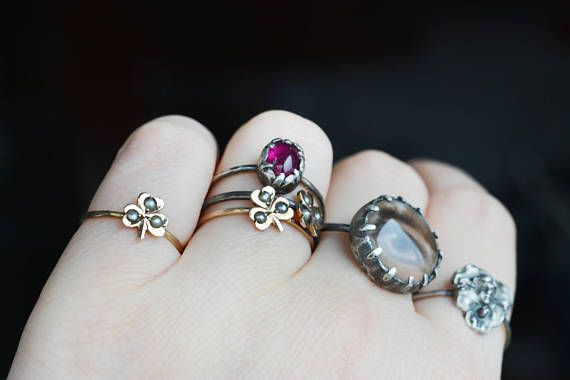 This is a vintage 9k solid gold seed pearl clover pinky ring or engagement ring transformed from a Victorian stick pin. It could also work as a midi or nuckle ring! I have 3 such rings, each a little bit different. Look for the other two in the shop! They all make great stackers! Tiny,