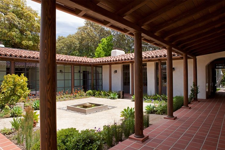 Modern Adobe House in Southern California by Dutton Architects: courtyard, with a central fountain, and edge plantings of native plants