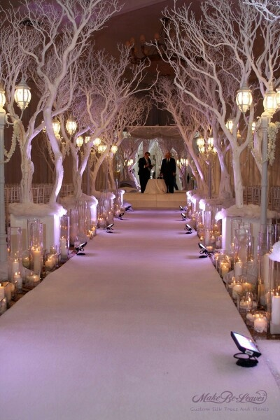 If I could do this with natural branches, I would love it! Then after the ceremony, disperse them around the room!
