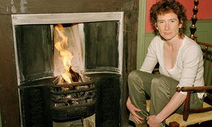 Jeanette Winterson by fireside at home.