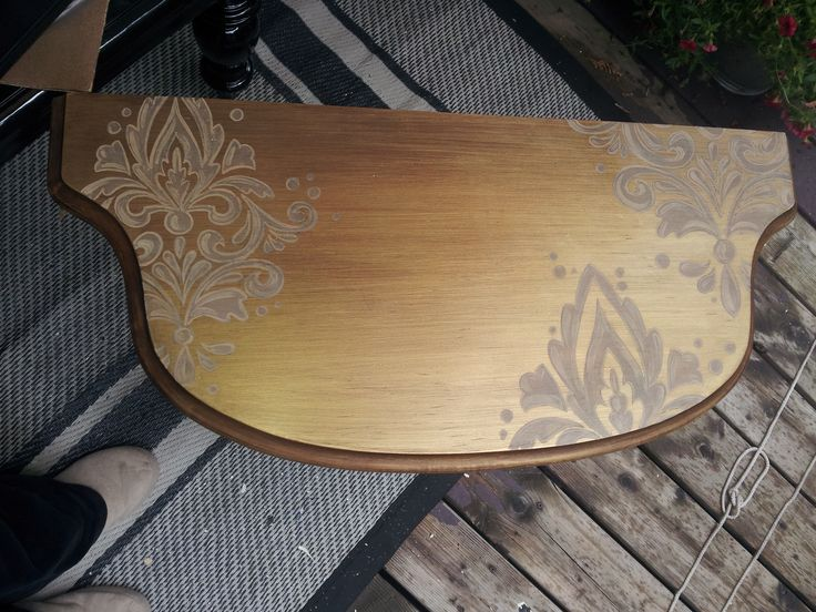 Gold half round table. After
