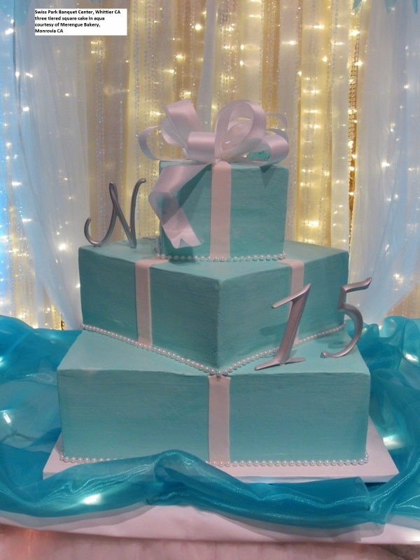 Beautiful three tiered square Quinceanera cake in aqua ...