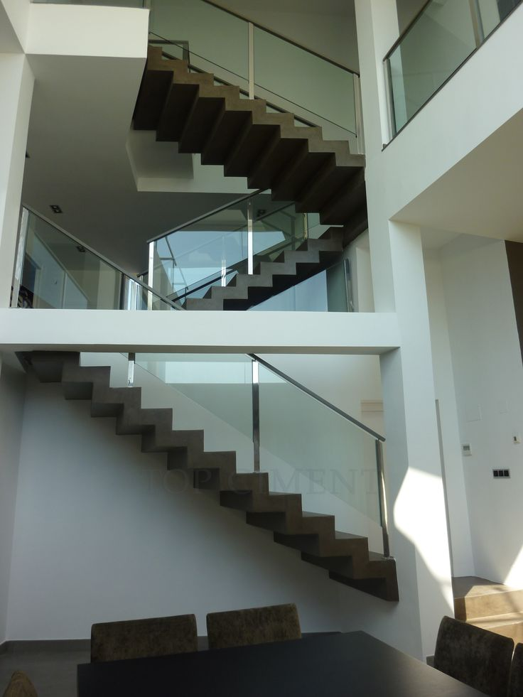 Just the right touch of dark colors - beautiful brown microcement stairs