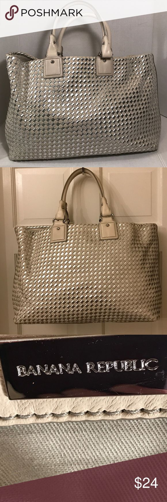"""Banana Republic large tote Metallic silver and cream colored design. Shell is cotton and polyurethane. Coating is rayon. Trim is lamb leather. Tote bag is large and sturdy to hold many items. In good preloved condition. Has a few nicks on straps and bottom that are so very tiny. Interior very clean in bottom but soiled slightly near zipper pocket. See pic4. 15.5"""" x 5.5"""" x 12"""" x 7"""" strap drop Banana Republic Bags Totes"""
